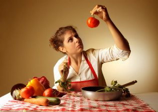 housewife controlling vegetables for recipe