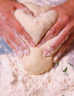 Heart moulded by hands from the dough